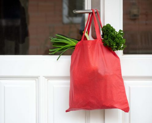 shopping, bag, door, quarantine, neighborhood, coronavirus, food, goods, help, hanging, front-door, service, infection, isolation, disease, epidemic, pandemic, delivery, health-care, curfew, health, care,  illness, virus, lockdown, house, home, pollution, patient, weak, old, senior, emergency, prevention, virus, danger, hygiene, safety, covid-19, sarscov2, influenza, bacteria, crisis, red, outdoors, concept, copy space, day
